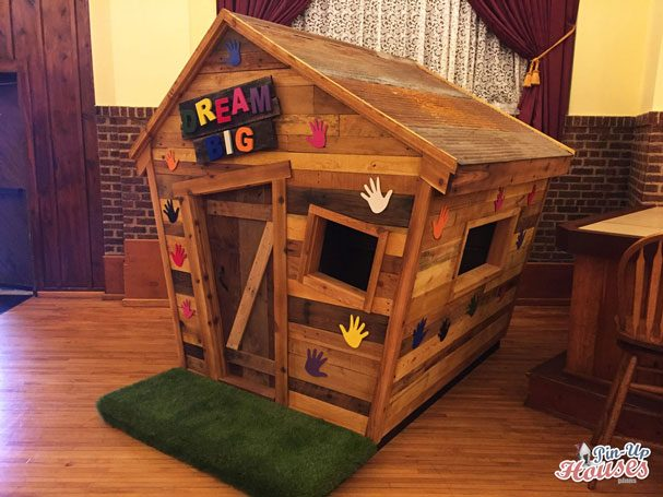 wooden playhouse with colorful decoration