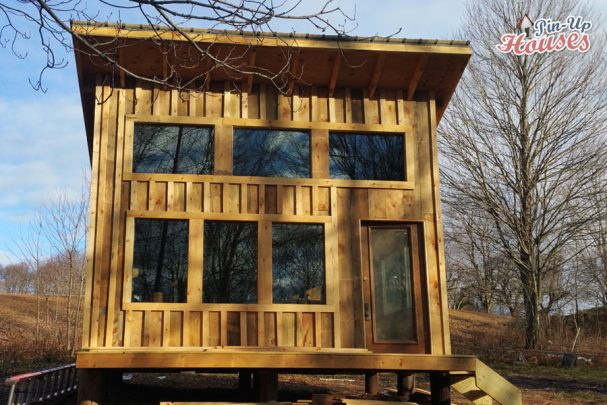 wood cabin with front porch