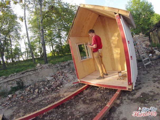 DIY tiny house construction window installation pin-up houses
