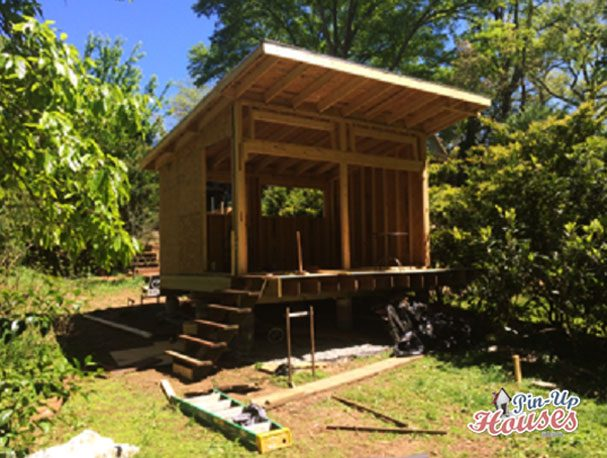 timber frame of cabin with OSB boards cladding