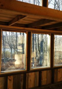 window frames in cabin with front porch