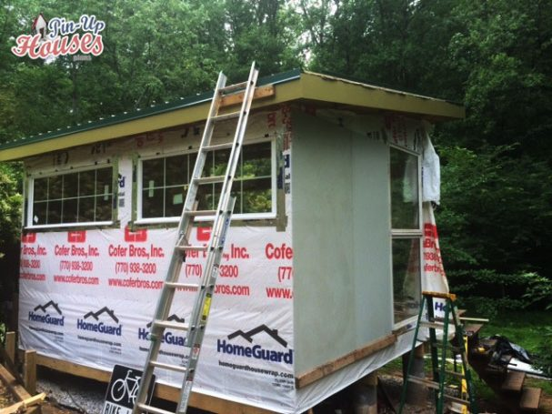 wall cladding of DIY wood cabin, metal roof sheeting